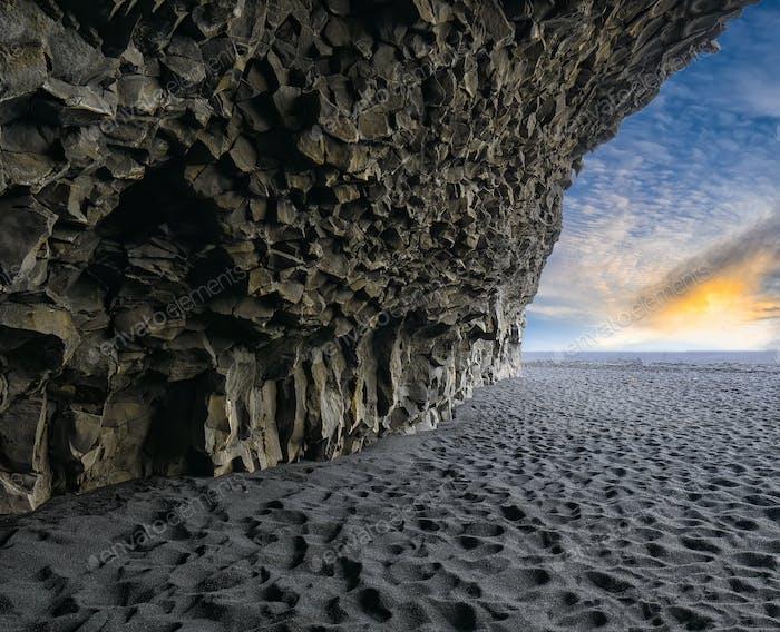 Amazing landscape with basalt rock formations  on Black beach Reynisfjara near the village of Vik