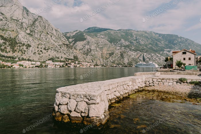 Sea bay fjord with mountains and cruise ship in Kotor Bay