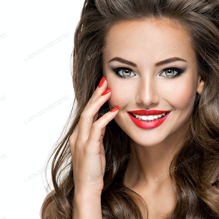 Closeup smiling face of  beautiful woman with  red lips and nail