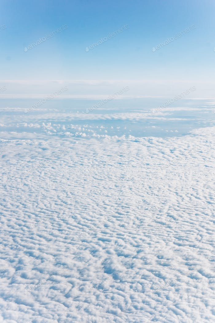 Fantastic background with clouds. The view above the clouds.