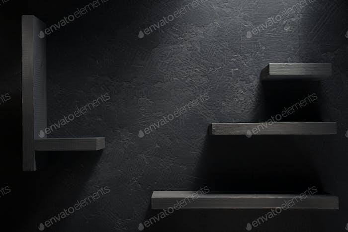 wooden shelf  on black