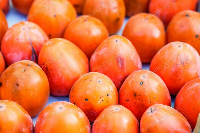 Persimmon fruits for sale in market close
