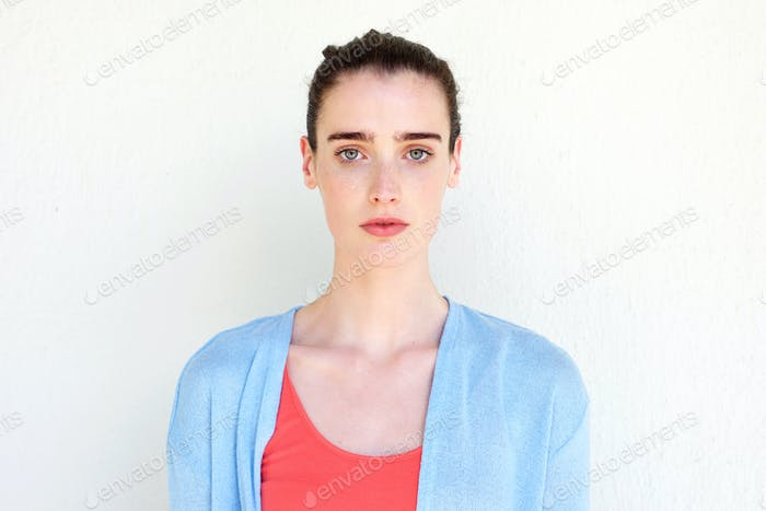 Healthy young woman against white wall