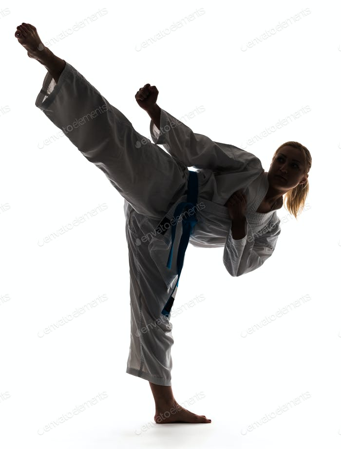 Karate woman posing standing on one leg