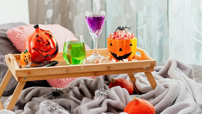 Halloween colorful drinks on tray with decor