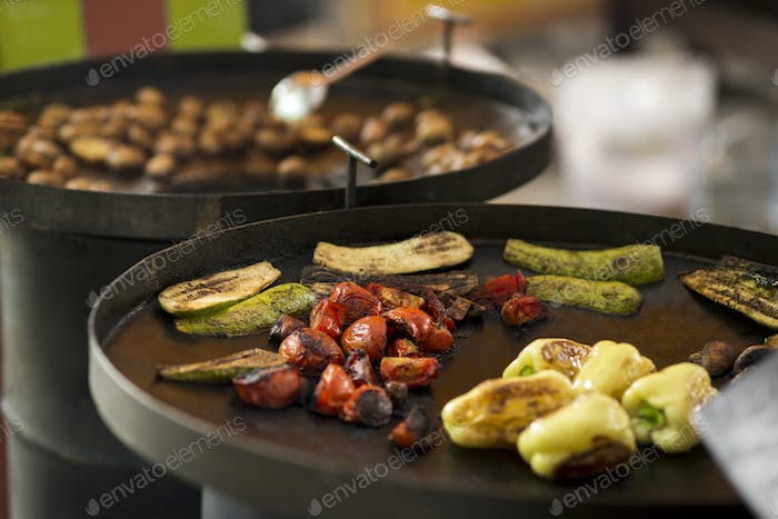 Hot grilled vegetables prepared for sale outdoor