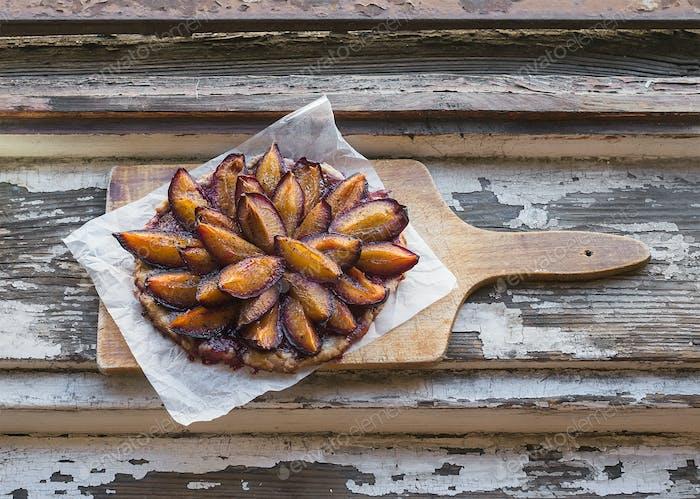 Plum pie on a wooden board