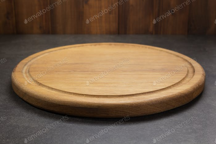 pizza cutting board at table in front