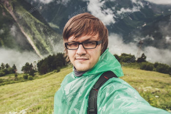 Man In Glasses Taking Selfie In The Mountains