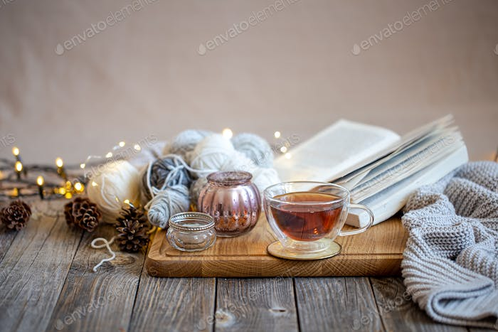 Cozy still life with tea and decorative items