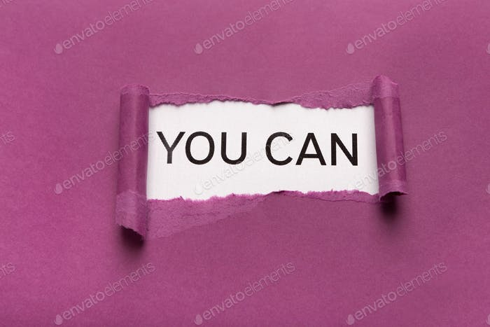 You can inscription on white background appearing behind torn purple paper