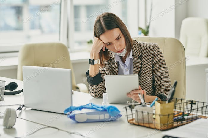 Businesswoman checking mail on tablet