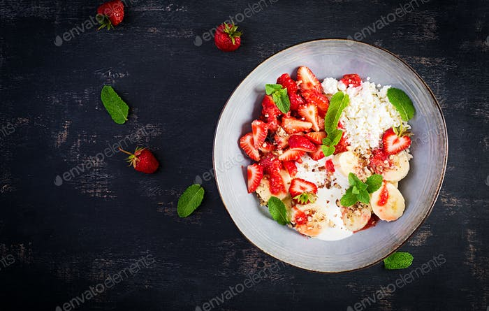 Cottage cheese or curd cheese with strawberries, bananas, walnuts