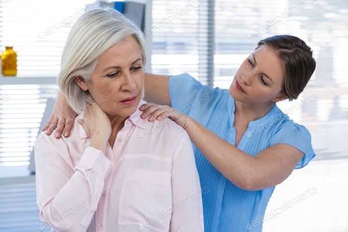 Doctor massaging a patient's shoulder