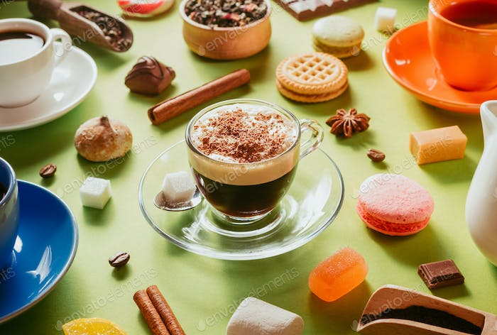 cup of coffee, tea and cacao at green background
