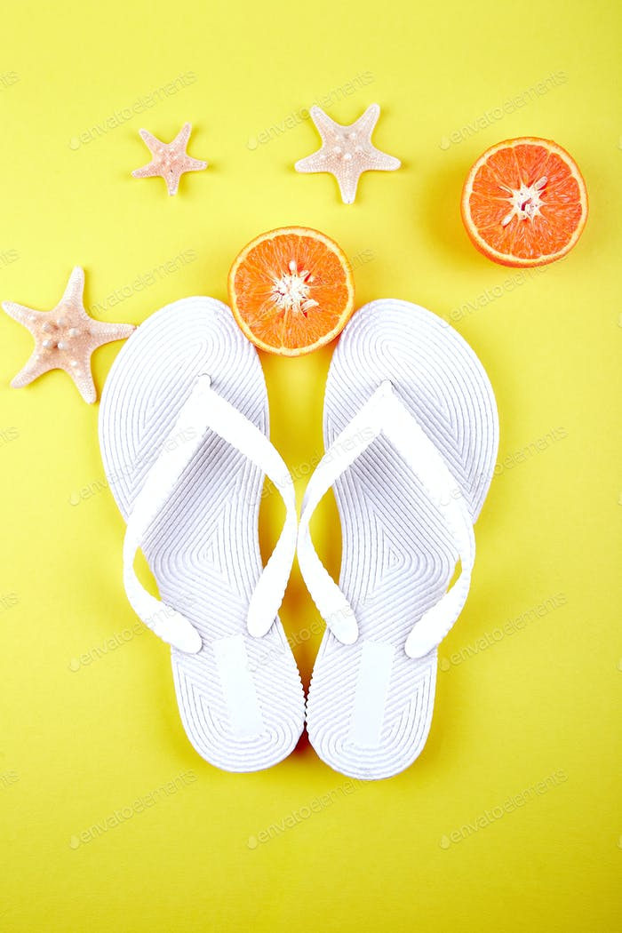 White Flip flops, Orange fruit, starfish