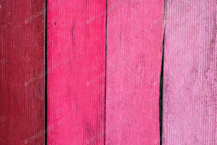 Pink wooden background of old boards