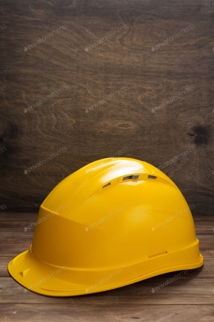 construction helmet on wooden table