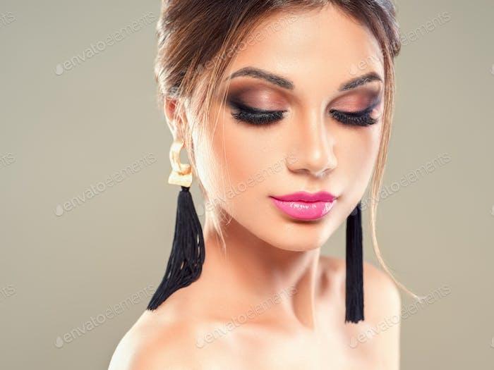 Beauty brunette woman makeup earrings beautiful hairstyle beauty lips lashes eyes model portrait