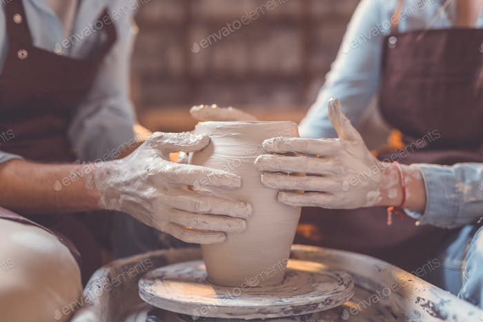 Young couple in pottery closeup