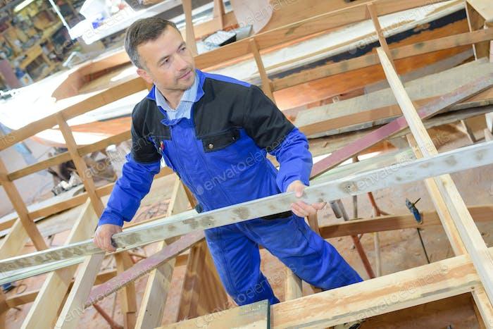 Man erecting timber frame