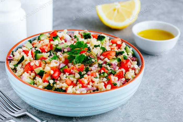 Couscous Tabbouleh Salad with fresh tomatoes, cucumbers and red onions