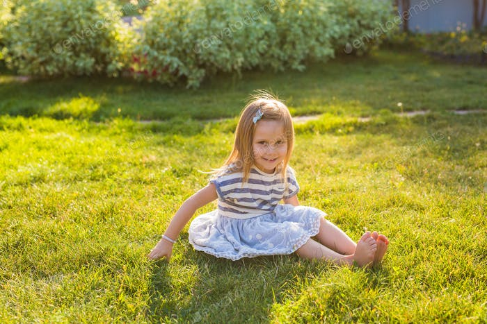 Sweet little girl play outdoors