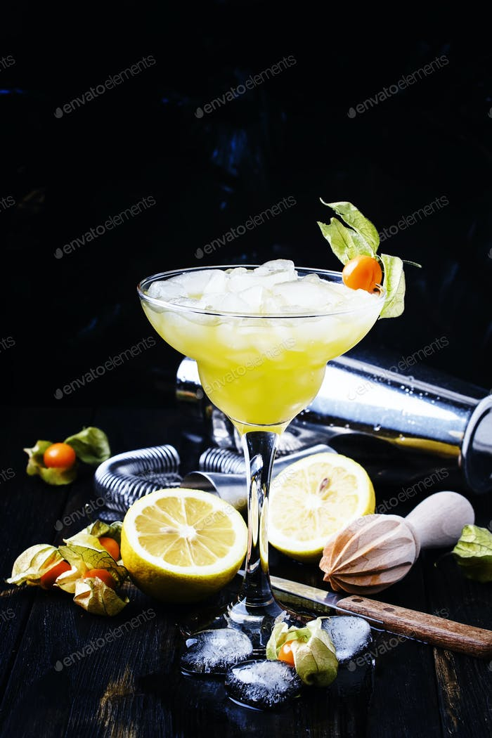 Alcoholic cocktail with beer, ice and lemon juice