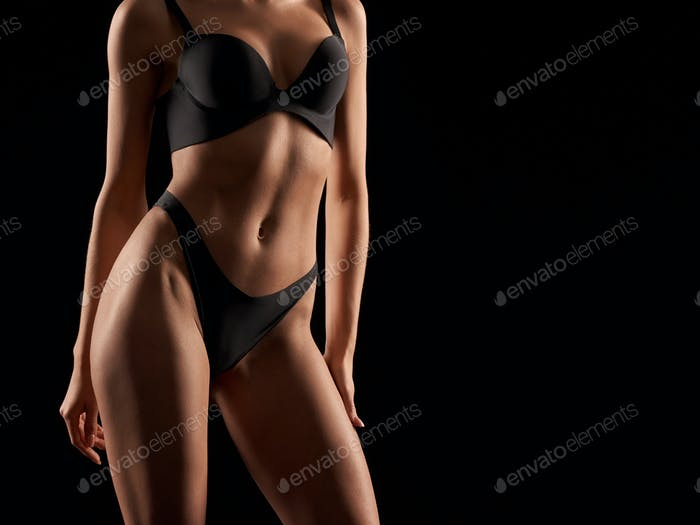 Female body in lingerie isolated on black
