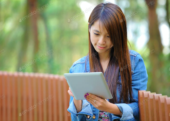 young asian woman with tablet computer