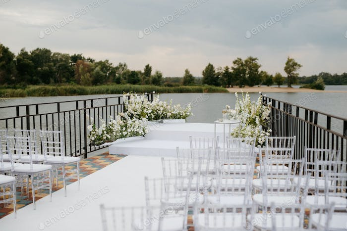 area for the wedding ceremony, on a stone pier