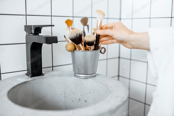 Makeup brushes on the sink in the bathroom