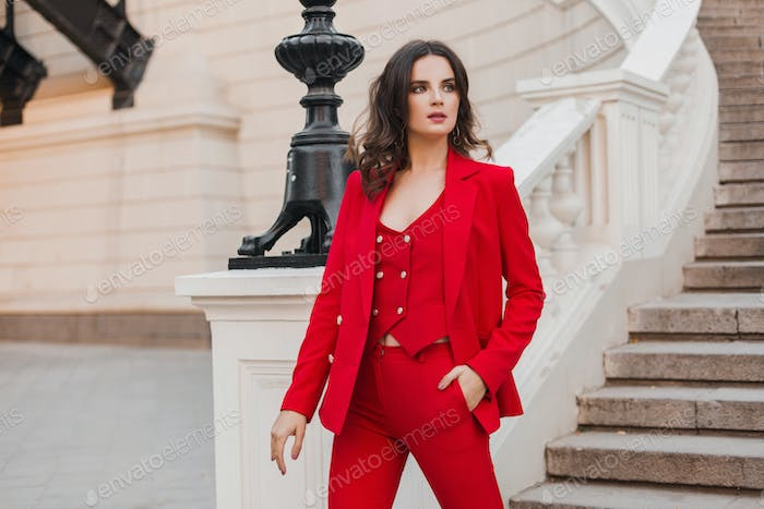 beautiful sexy rich business woman in red suit walking in city street, spring summer fashion trend
