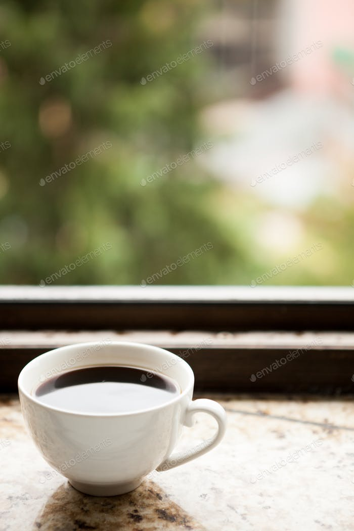 Coffee mug on a window sill