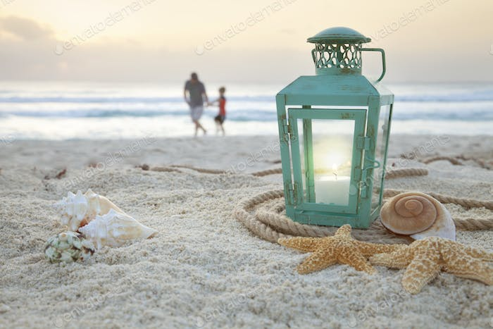 Lantern on the Beach with a Father and Son Collecting Shells in the Background