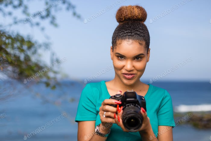 African American woman  photographer taking outdoor photos -  Black people