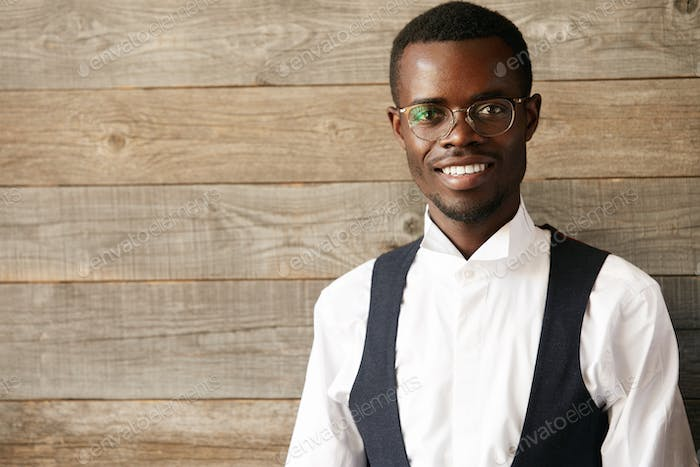 Succes and achievement concept. Headshot of black student in formal clothes, looking at the camera w