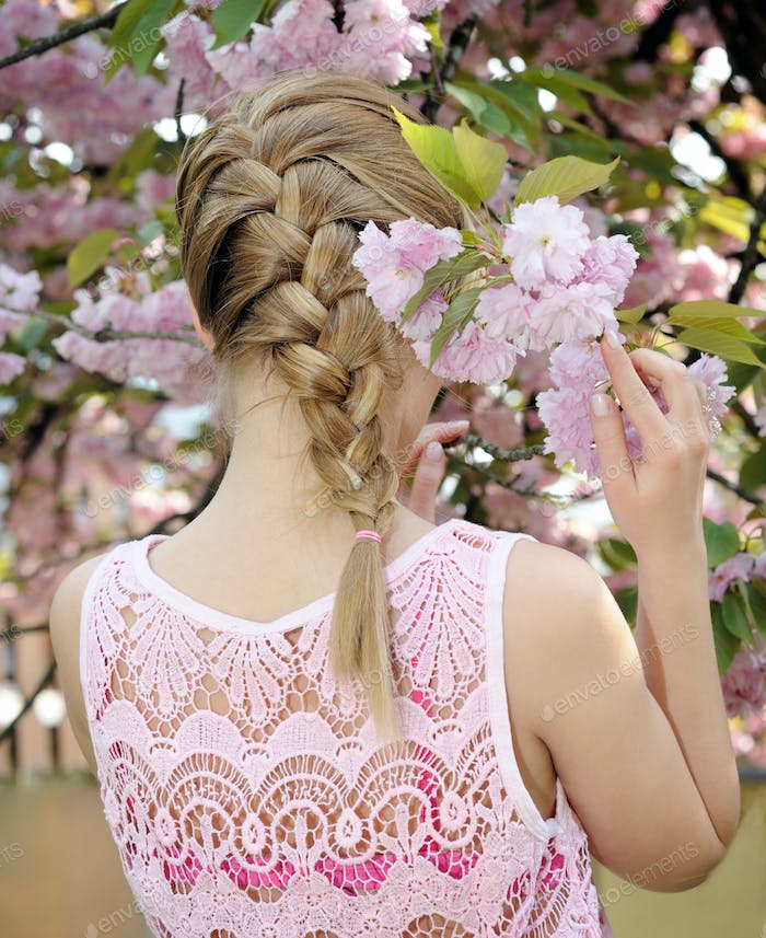 blond girl with stylish plait
