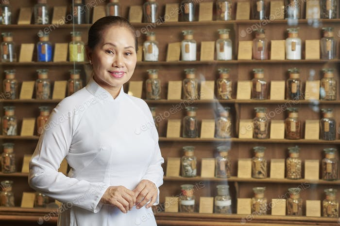 Asian apothecary owner