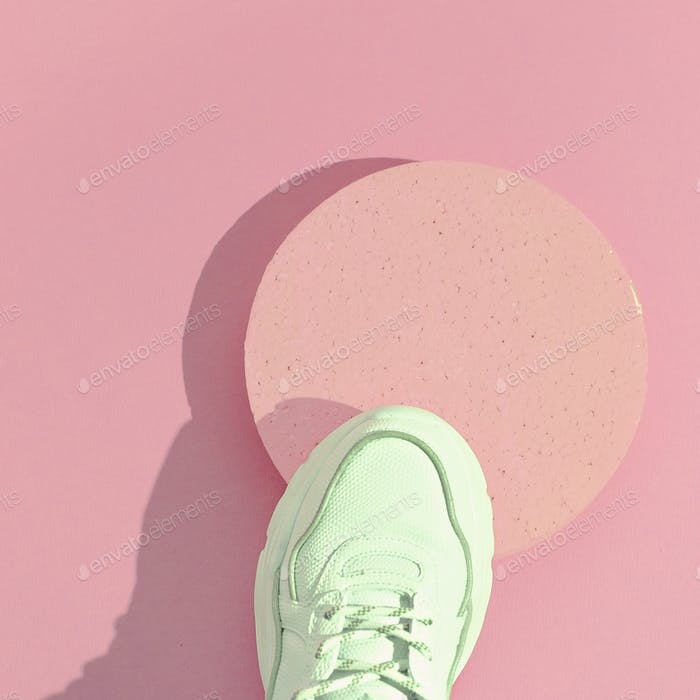 Minimal still life art. Fashion sport shoes concept. Pink colours trends. Stylish white sneakers