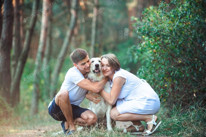 Happy couple of future parents with pet