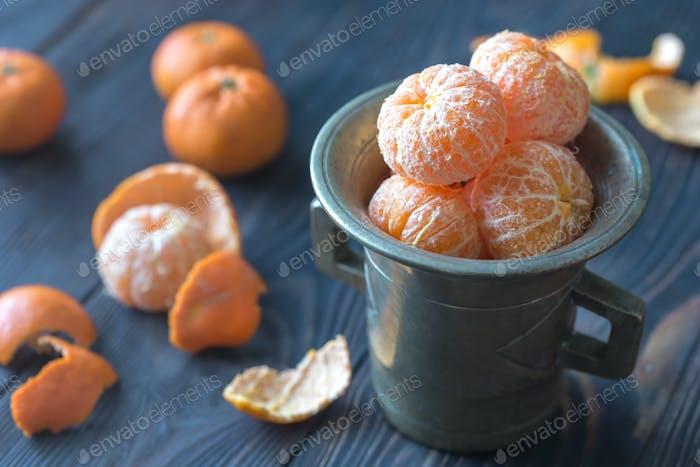 Peeled tangerines in the vintage cup