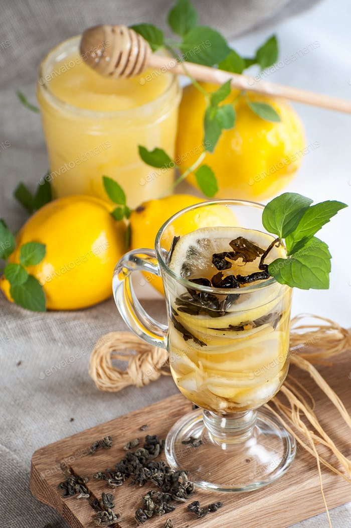 A cup of freshly lemon tea with fresh mint.