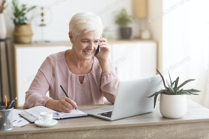 Ambitious elderly business lady working from home