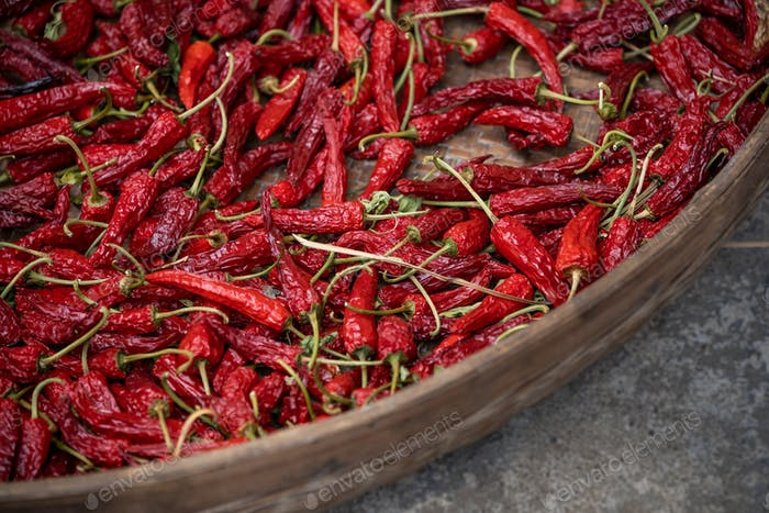 Chili drying in a wicker bowl