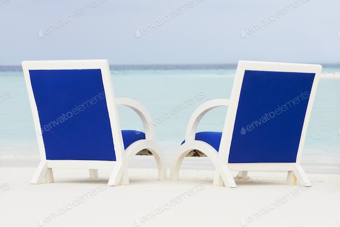 Empty Chairs On Beautiful Tropical Beach