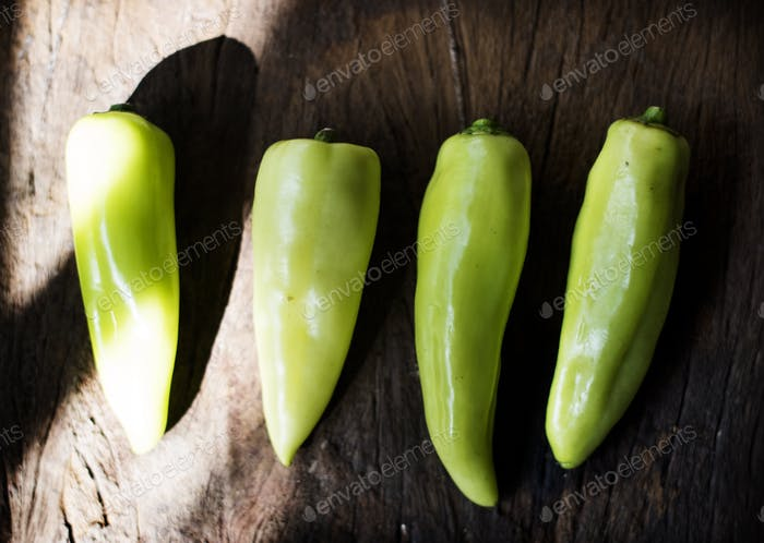 Aerial view of fresh jalapeno pepper on wooden background