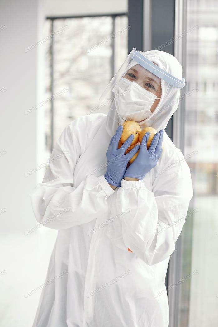Women doctor wearing protective suit