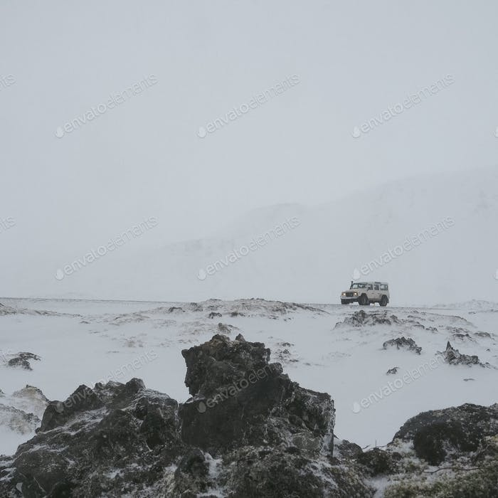 Adventure vehicle in a snowstorm