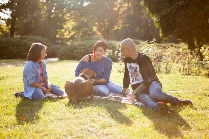Beautiful gorgeous family of three playing in the park with thei